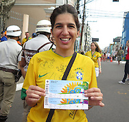 A Brazlian fan with her tickets prior to the 2014 FIFA World Cup match at the Itaipava Arena Fonte Nova, Nazare, Bahia<br /> Picture by Stefano Gnech/Focus Images Ltd +39 333 1641678<br /> 05/07/2014