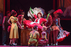 "© Licensed to London News Pictures. 14/05/2014. London, England. Christine Rice as Dorabella. Dress rehearsal of the Wolfgang Amadeus Mozart opera ""Così fan tutte"" at the London Coliseum. A new ENO production of Mozart's dark comedy set in the world of a 1950's Coney Island funfair. With Kate Valentine as Fiordiligi, Christine Rice as Dorabella, Marcus Farnsworth as Guglielmo, Randall Bills as Ferrando, Mary Bevan as Despina and Roderick Williams as Don Alfonso. Directed by Phelim McDermott, Conductor: Ryan Wigglesworth. Co-produced by the English National Opera and the Metropolitan Opera, New York. In collaboration with Improbable. 12 performances from 16 May to 6 July 2014. Photo credit: Bettina Strenske/LNP"