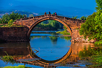 A beautiful arched bridge on the outskirts of the market town of Shaxi, on the Tea Horse Caravan Road, which links Southern Yunnan to Tibet and Burma and retains its position as one of the best preserved historic market hubs today.