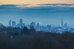 "Steam rises from skyscrapers in The City, seen from Hampstead Heath. The threatened snow from ""The Beast From The East"" weather system doesn't materialise overnight in London leaving a crisp, clear morning in North London. London, February 27 2018."