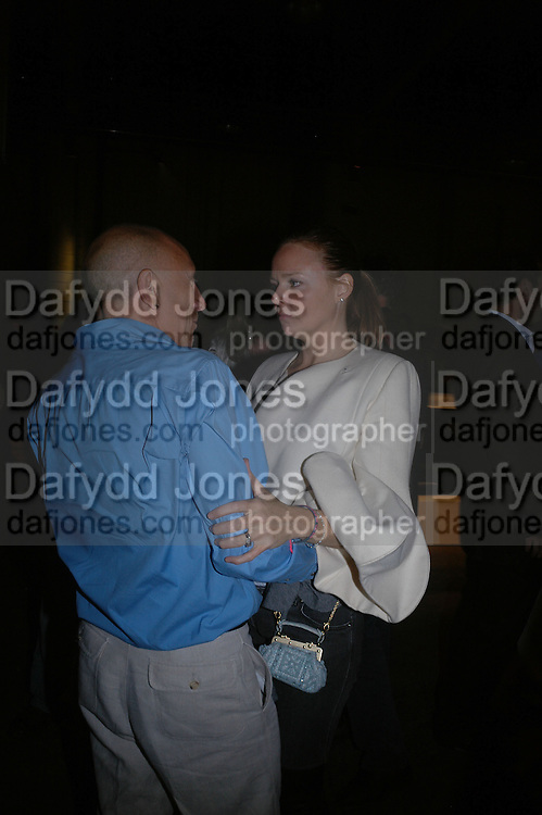 Stella McCartney and Brian Clarke, Established and Sons UK Launch during Design Week. The Bus Depot, Hertford Road. Hoxton. 22 September 2005.  ONE TIME USE ONLY - DO NOT ARCHIVE © Copyright Photograph by Dafydd Jones 66 Stockwell Park Rd. London SW9 0DA Tel 020 7733 0108 www.dafjones.com