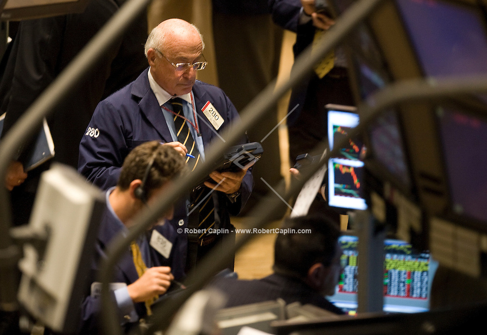 Brokers work on the floor of the New York Stock Exchange Oct. 30, 2007. Photographer: Robert Caplin/Bloomberg News