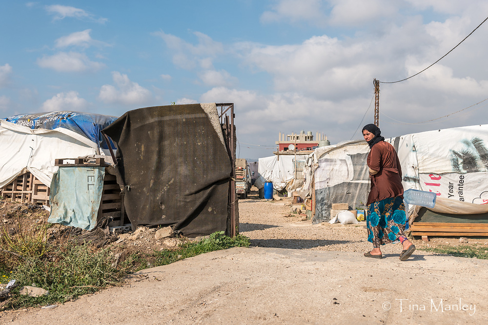 Syrian migrant workers live in camps in Minyara, Lebanon.