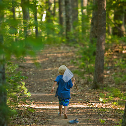 A boy walks with his fishing net in Greenfield State Park in Greenfield, New Hampshire.