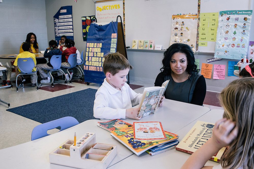 Leckie Elementary principal Atasha James, center, visits students, including Jack Hillberg, 8, whose family is in the Air Force, during class on Monday, March 16, 2015.