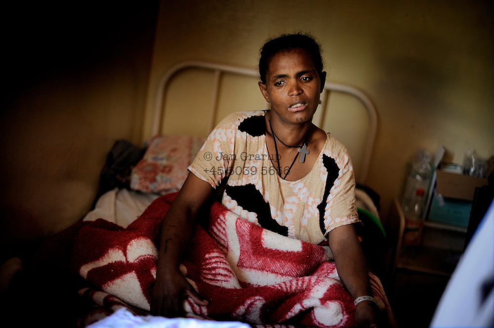 A patient of the Hamlin Fistula Hospital waits for her C-Section at the Gandhi Memorial Hospital in Addis Abeba. The Fistula Centre provides care for former patients when they are pregnant again, arranging for doctor's visits and operations as most will not be able to have a normal delivery. The women can stay in the maternity ward of the Fistula Hospital for up to 2 months before delivery and are driven by staff to the general hospital for the C-section.
