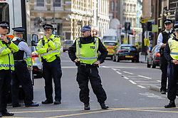 © Licensed to London News Pictures. 04/06/2017. London, UK. Police cordons continue to be in place around London Bridge after the previous night's terrorist attack where a reported three attackers were shot by the police and seven members of the public died after being attacked with knives.  Photo credit : Stephen Chung/LNP