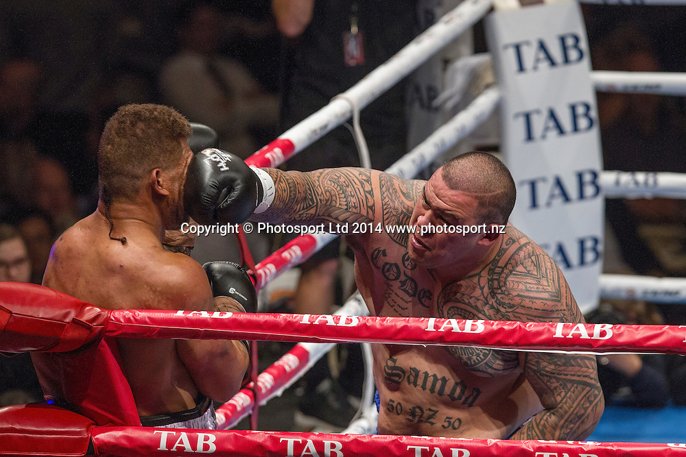Dave (Brown Buttabean) Letele, right, lands a punch as he  fights Lopini (MVPHorse) Vatuvei at the Hydr8 Zero Heavyweight Explosion, Vodafone Events Centre, Auckland, New Zealand, Saturday, July 05, 2014. Photo: David Rowland/Photosport