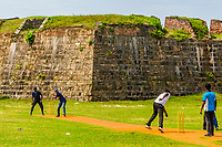 Boys playing cricket, Fort Frederick, Trincomalee, Sri Lanka.