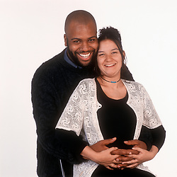Mixed race couple, woman is pregnant