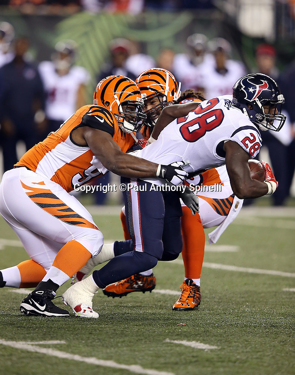 Houston Texans running back Alfred Blue (28) gets tackled by Cincinnati Bengals defensive tackle Geno Atkins (97) as he runs for a 9 yard gain in the first quarter during the 2015 week 10 regular season NFL football game against the Cincinnati Bengals on Monday, Nov. 16, 2015 in Cincinnati. The Texans won the game 10-6. (©Paul Anthony Spinelli)