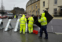 © Licensed to London News Pictures. 31/01/2014; Bristol, UK.  A portable flood barrier is set up in Avon Crescent near Bristol docks, to protect a row of houses from possible flooding from the river Avon at high tide this weekend.  31 January 2014.<br /> Photo credit: Simon Chapman/LNP