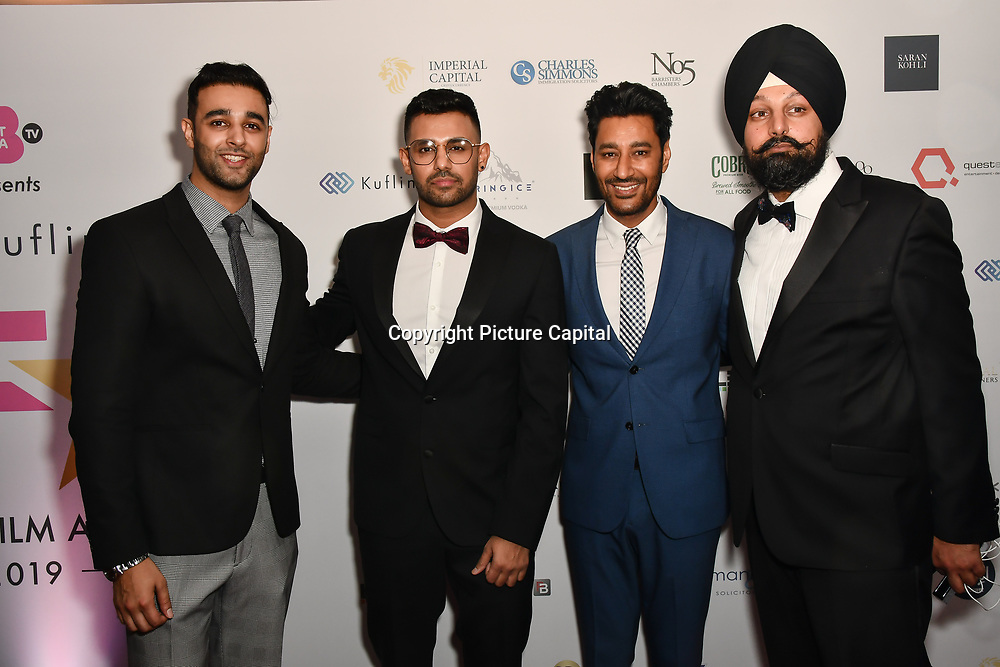 Avkash Mann, guest, Harbhajan Mann and guest attend the BritAsiaTV Presents Kuflink Punjabi Film Awards 2019 at Grosvenor House, Park Lane, London,United Kingdom. 30 March 2019