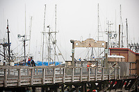 Scenes from Newport, Oregon including fishing boats and the Yaquina bridge and crabbing baskets.