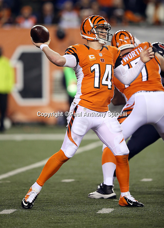 Cincinnati Bengals quarterback Andy Dalton (14) throws a fourth quarter pass during the 2015 week 10 regular season NFL football game against the Houston Texans on Monday, Nov. 16, 2015 in Cincinnati. The Texans won the game 10-6. (©Paul Anthony Spinelli)