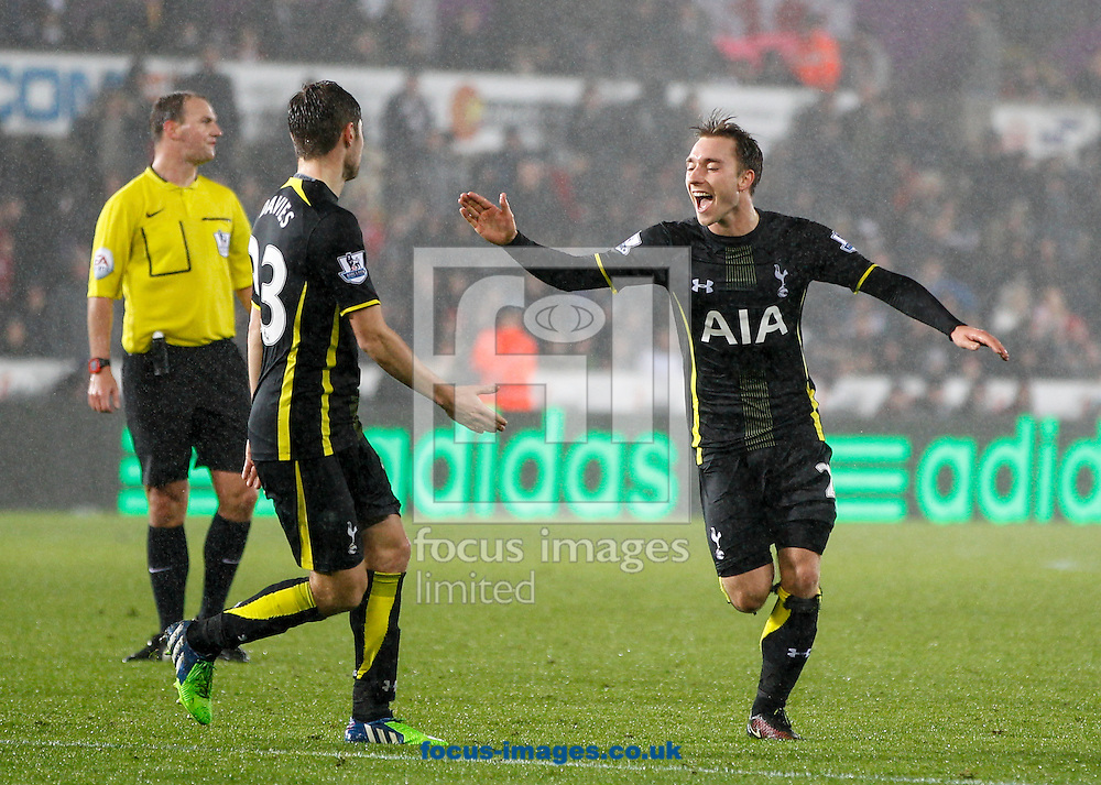 Christian Eriksen (R) scores the second goal for Tottenham Hotspur during the Barclays Premier League match at the Liberty Stadium, Swansea<br /> Picture by Mike Griffiths/Focus Images Ltd +44 7766 223933<br /> 14/12/2014