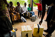 Health workers and volunteers gather at the Savelugu hospital as they prepare to head off to vaccinate children during a national polio immunization exercise in Savelugu, northern Ghana on Friday March 27, 2009.