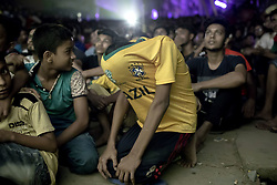 July 7, 2018 - Dhaka, Dhaka, Bangladesh - July 07, 2018 - Dhaka, Bangladesh – Bangladeshi football fans watch the Russia 2018 World Cup football matches between Brazil and Belgium on a big screen in Dhaka. (Credit Image: © K M Asad via ZUMA Wire)