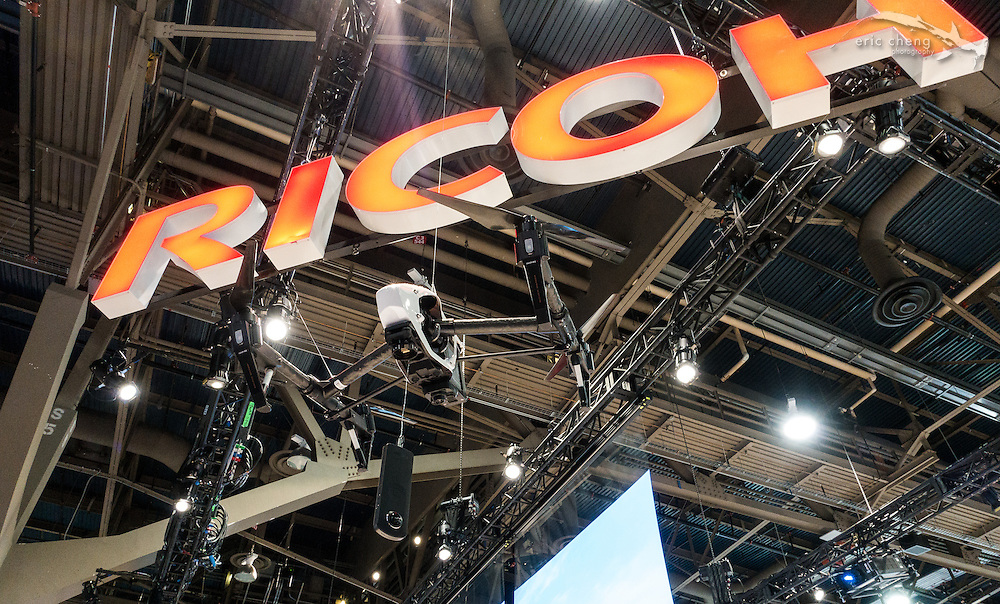A Ricoh Theta S 360 camera dangles below a DJI Inspire 1 at the Ricoh booth. CES 2016, Las Vegas.