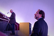 """Garden City, New York, USA. May 23, 2019. At left, ANDREW PARTON, President of the Cradle of Aviation Museum is standing at lectern and introducing, at right, ANDREW CHAIKIN, best-selling author of """"A Man on the Moon: The Voyages of the Apollo Astronauts"""" in the museum's JetBlue Sky Theater Planetarium. During Chaikin's talk, he reminisced about growing up on Long Island during the Apollo space program and interviewing Apollo astronauts. Event was part of CAM's celebration of 50th Anniversary of Apollo 11."""