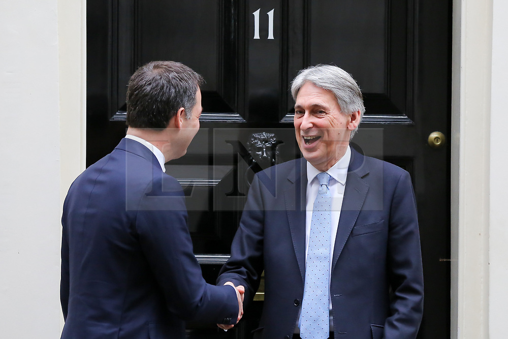 © Licensed to London News Pictures. 06/03/2019. London, UK. Philip Hammond - Chancellor greets Alexander De Croo, Deputy Prime Minister of Belgium and Minister of Finance and Development Cooperation outside No 11 Downing Street. Photo credit: Dinendra Haria/LNP