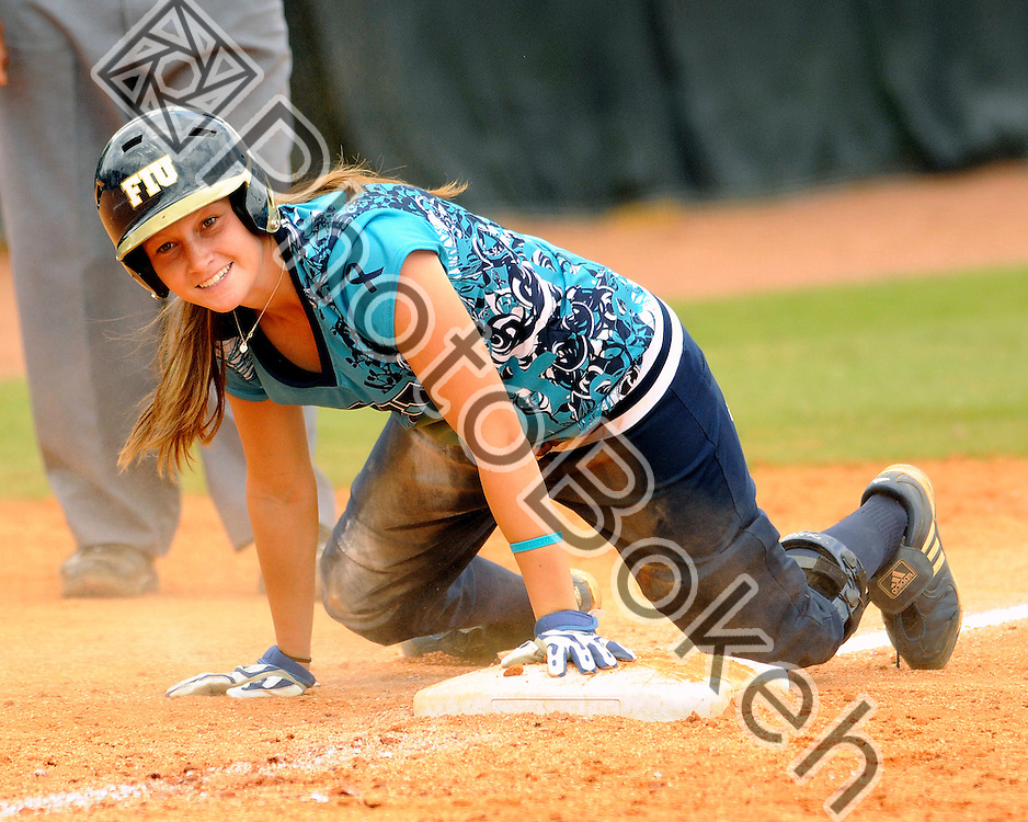 2011 April 4 - FIU Kayla Burri (7) sliding into third base. Florida International University defeated Western Kentucky, 13-2, in six innings at the FIU Softball Complex, Miami, Florida. (Photo by: www.photobokeh.com / Alex J. Hernandez)