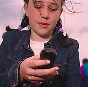 Girl looking at her mobile phone Cardiff