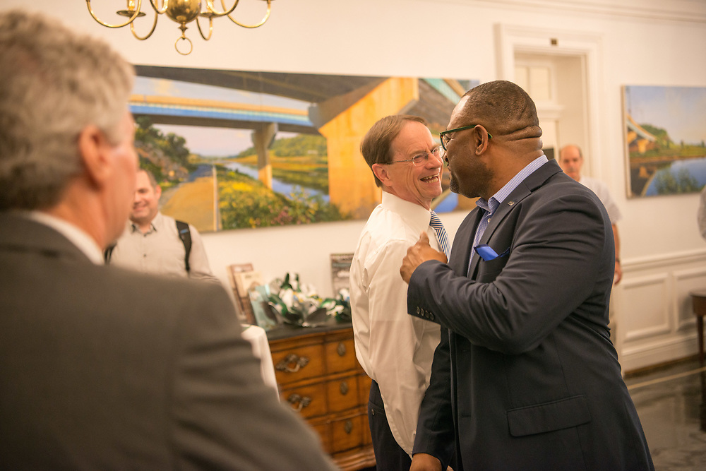 David Descutner and Ty Carr talk at a reception for President Nellis at Cutler Hall.