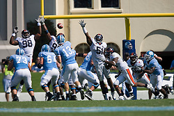 Virginia NT Nate Collins (98), Virginia defensive end Jeffrey Fitzgerald (95) and Virginia linebacker Clint Sintim (51) leap to block a pass from North Carolina quarterback T.J. Yates (13) pass on UNC's 2 point conversion attempt near the end of the game. The North Carolina Tar Heels football team faced the Virginia Cavaliers at Kenan Memorial Stadium in Chapel Hill, NC on September 15, 2007.  UVA defeated UNC 22-20.