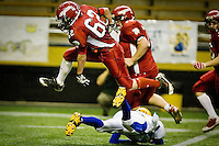 JEROME A. POLLOS/Press ..Kootenai High's Levi Killian hurdles a Carey High defender during the 1A District II State Championship Game Friday in Moscow.