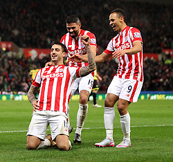 Joselu of Stoke City celebrates scoring a goal against Norwich City with Jonathan Walters and Peter Odemwingie - Mandatory byline: Robbie Stephenson/JMP - 13/01/2016 - FOOTBALL - Britannia Stadium - Stoke, England - Stoke City v Norwich City - Barclays Premier League