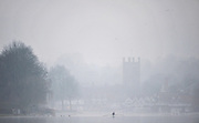 Henley, Great Britain,  General Views,  Henley Reach, and Church Tower Henely Town  Single and  training in the early morning ground mist, Henley on Thames Oxfordshire, Great Britain. Thursday,  21/01/2010. [Mandatory Credit. Peter Spurrier/Intersport Images]