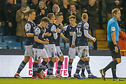 GOAL 1-0 Millwall midfielder Shaun Williams (6) scores and celebrates during the EFL Sky Bet Championship match between Millwall and Nottingham Forest at The Den, London, England on 6 December 2019.