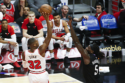 March 15, 2019 - Los Angeles, California, U.S - Chicago Bulls' Kris Dunn (32) shoots over Los Angeles ClippersÃ• Montrezl Harrell (5) during an NBA basketball game between Los Angeles Clippers and Chicago Bulls Friday, March 15, 2019, in Los Angeles. The Clippers won 128-121. (Credit Image: © Ringo Chiu/ZUMA Wire)