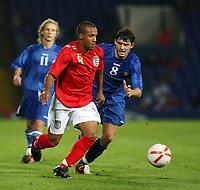 Photo: Chris Ratcliffe.<br /> England U21 v Moldova U21. European Championship Qualifier. 15/08/2006.<br /> Wayne Routledge of England U21 clashes with Alexandru Gatcan of Moldova U21.