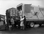 05/09/1961<br /> 09/05/1961<br /> 05 September 1961<br /> Special for Urney Chocolates Belgard Road, Tallaght, Dublin and Coras Trachtala . Forklift loading chocolates for export onto truck  at the Irish Urney factory.Supervised by Mr T Headon in white coat