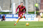 Tom Aldred (#5) of Motherwell FC runs with the ball during the Ladbrokes Scottish Premiership match between St Johnstone and Motherwell at McDiarmid Stadium, Perth, Scotland on 11 May 2019.