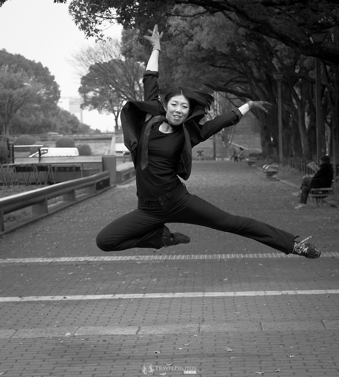 A professional Japanese dancer posing in a Japanese city.