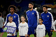 Chelsea FC forward Willian (22), Chelsea FC forward Oliver Giroud (18) and Chelsea FC midfielder Cesc Fabregas (4) before the Europa League group stage match between Chelsea and BATE Borisov at Stamford Bridge, London, England on 25 October 2018.
