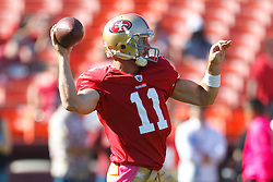 Oct 30, 2011; San Francisco, CA, USA; San Francisco 49ers quarterback Alex Smith (11) warms up before the game against the Cleveland Browns at Candlestick Park. San Francisco defeated Cleveland 20-10. Mandatory Credit: Jason O. Watson-US PRESSWIRE