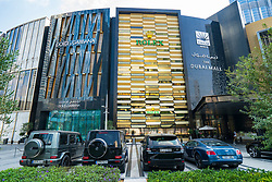 Exterior of Dubai Mall Fashion Avenue with luxury cars Parked outside, Downtown Dubai, United Arab Emirates