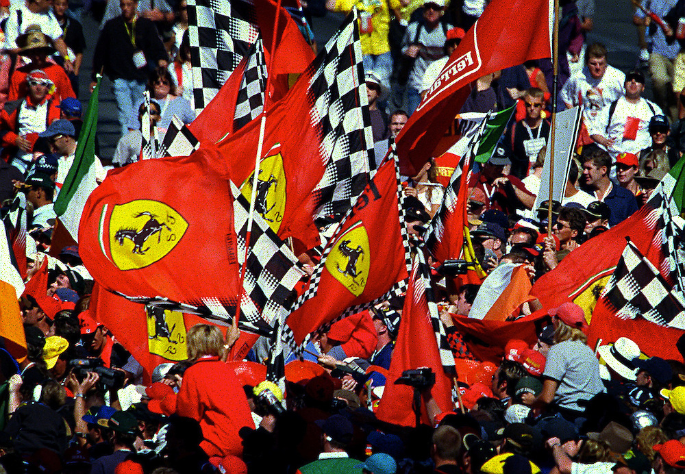 csz990307.001.020.pic by craig sillitoe, news.australian formula on grand prix, crowds carrying ferrari flags swarm the track after eddie irvine's win melbourne photographers, commercial photographers, industrial photographers, corporate photographer, architectural photographers, This photograph can be used for non commercial uses with attribution. Credit: Craig Sillitoe Photography / http://www.csillitoe.com<br />