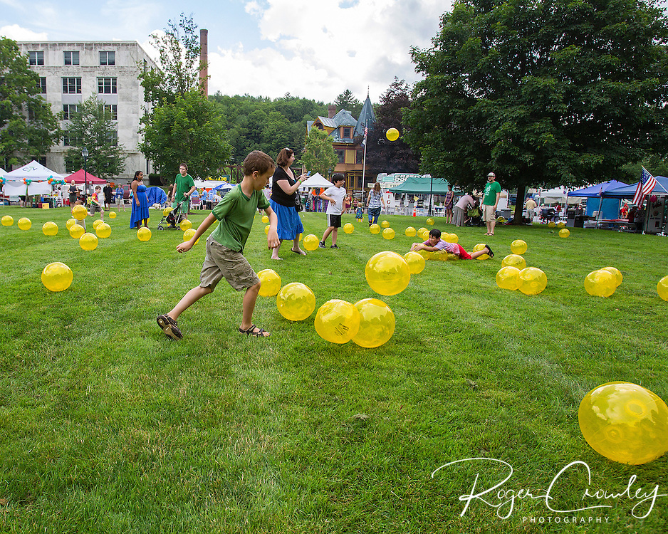 Energy Smart of Vermont provided hundreds of inflated yellow balls for kids to play with on the State House lawn during July 3rd celebrations in Montpelier.