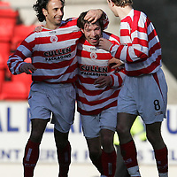St Johnstone v Hamilton..05.03.05<br />Mark Corcoran celebrates his goal with paquito and Lee Hardy<br /><br />Picture by Graeme Hart.<br />Copyright Perthshire Picture Agency<br />Tel: 01738 623350  Mobile: 07990 594431
