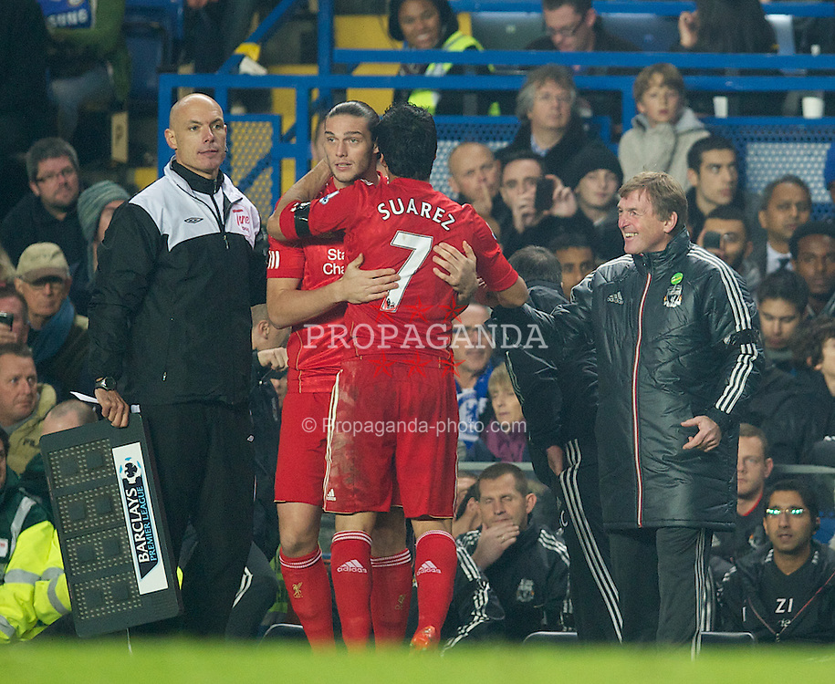 LONDON, ENGLAND - Sunday, November 20, 2011: Liverpool's manager Kenny Dalglish applauds Luis Alberto Suarez Diaz as he is substituted for Andy Carroll against Chelsea during the Premiership match at Stamford Bridge. (Pic by David Rawcliffe/Propaganda)