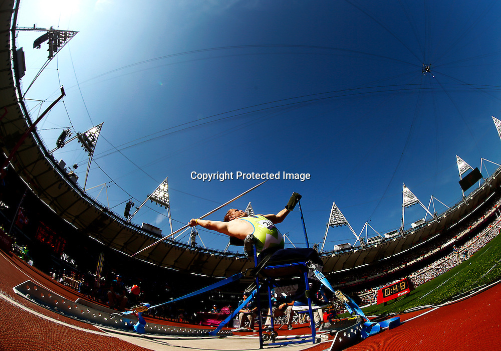 A picture taken with an extreme wide angle lens shows Henrik Plank of Slovenia competing in the men's Javelin Throw F52/53 final at the Olympic Stadium during the London 2012 Paralympic Games in London, Britain, 04 September 2012.  EPA/KERIM OKTEN
