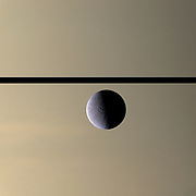 The Cassini spacecraft looks toward Rhea, Saturn's second-largest moon