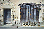 Traditional weathered French doorway in quaint town of Castelmoron d'Albret in Bordeaux region, Gironde, France