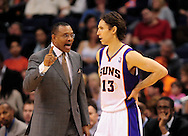 Feb. 4, 2012; Phoenix, AZ, USA; Phoenix Suns head coach talks to guard Steve Nash (13) on the court while playing against the Charlotte Bobcats during the second half at the US Airways Center. The Suns defeated the Bobcats 95 - 89. Mandatory Credit: Jennifer Stewart-US PRESSWIRE.
