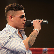 Professional boxer Orlando Cruz, the first openly gay boxer, speaks to the crowd during a Telemundo boxing match at the Kissimmee Civic Center on Friday, July 17, 2015 in Kissimmee, Florida.  (AP Photo/Alex Menendez)